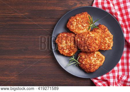 Juicy Meat Cutlets (beef, Pork, Chicken) In Table On Black Background. Top View