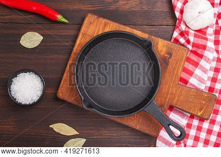 Empty Cutting Board On Wooden Table And Spice, Pepper, Salt. Cookung Food Background For Menu In Rus