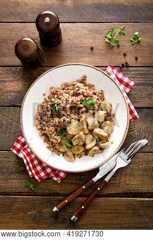 Mushroom Buckwheat Porridge Bowl With Fresh Parsley