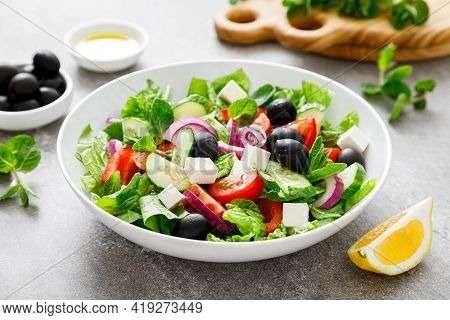 Fresh Vegetable Greek Salad With Lettuce, Olives And Feta Cheese