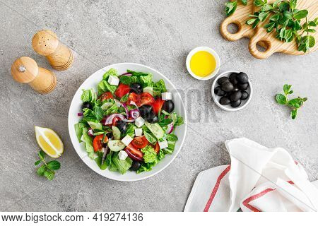 Fresh Vegetable Greek Salad With Lettuce, Olives And Feta Cheese, Top View