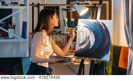Painting Art. Creative Hobby. Talent Skill. Inspired Left-handed Female Artist Using Paintbrush Pale