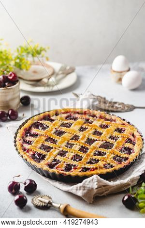 Delicious Homemade Classic Cherry Pie With A Flaky Crust On White Background