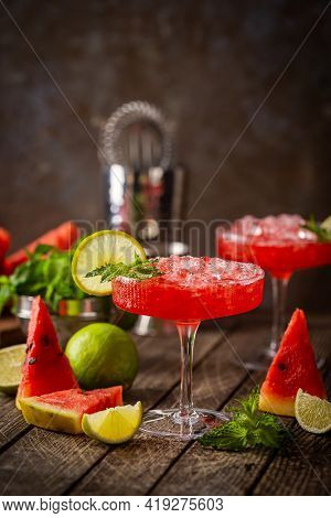 Watermelon Frozen Cocktail Margarita With Fresh Watermelon, Lime And Mint On Wooden Background