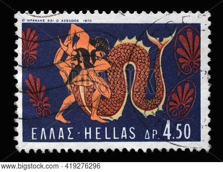 ZAGREB, CROATIA - SEPTEMBER 18, 2014: Stamp printed in Greece shows Hercules Deeds - Hercules and River Acheloos, circa 1970