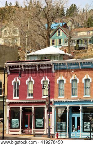 April 25, 2021 In Central City, Co:  Renovated Vintage Buildings With Houses On A Hillside Beyond Ta