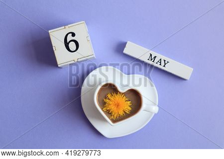 Calendar For May 6: A Cube With The Number 6, The Name Of The Month Of May In English, A Cup Of Coff