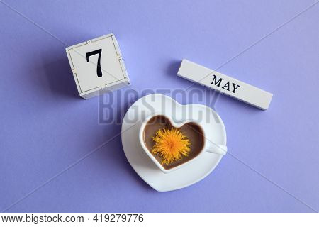 Calendar For May 7: A Cube With The Number 7, The Name Of The Month Of May In English, A Cup Of Coff