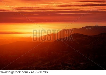 Beautiful scenic sunset over hills with Hollywood Sign. Los Angeles, Southern California.
