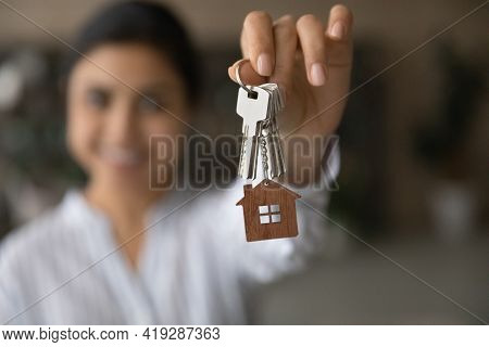 Close Up Focus On Keys, Excited Tenant Rejoicing Relocation