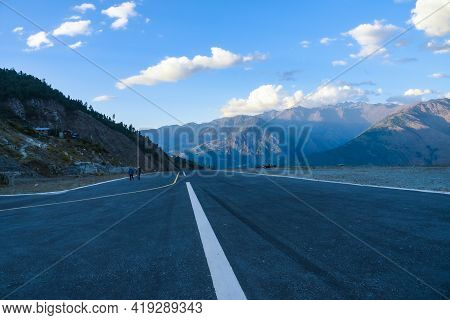 Mountain And Airport Runway, Low Angle Runway View