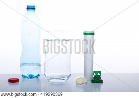 Glass Filled With Mineral Water. Mineral Water On A White Background. Water And Medicines. Front Vie
