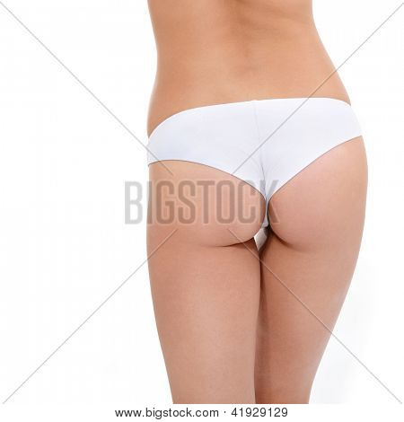 buttocks of young woman in underwear showing absence of cellulite over white background