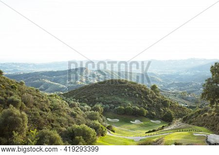 Cloudy Sunset Landscape. Mountain With Vegetation. No People