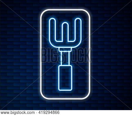 Glowing Neon Line Garden Rake Icon Isolated On Brick Wall Background. Tool For Horticulture, Agricul