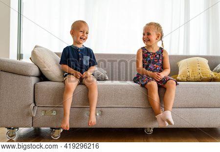 Preschool Children Boy And Girl Sit Together. Happy Childhood, Parenting, Kid Concept.