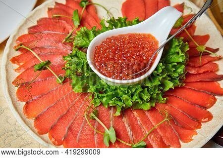 Lightly Salted Salmon And Red Caviar On A White Plate. Close-up, Selective Focus