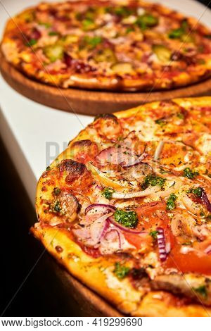 Fresh Pizza With Bacon, Mushrooms And Cheese On A Light Background. Close-up, Selective Focus
