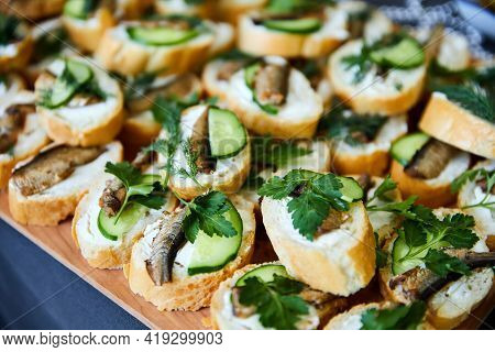 Sandwiches With Sprats, Fresh Cucumber And Parsley. Close-up, Selective Focus