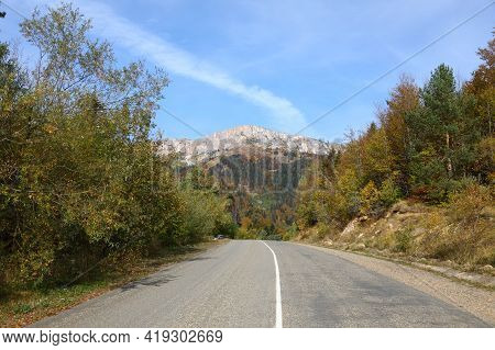 Sunny Autumn Day Over Road On Caucasus Mountains In Adygea, Russia