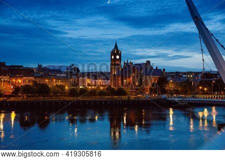 Derry, Ireland. Illuminated Peace Bridge In Derry Londonderry, City Of Culture, In Northern Ireland
