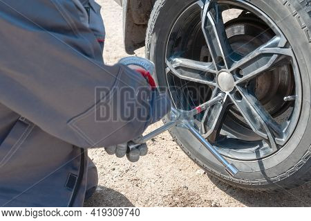 Wheel Replacement On The Road By The Driver. Replacing Summer Tires With Winter Tires With A Handy W