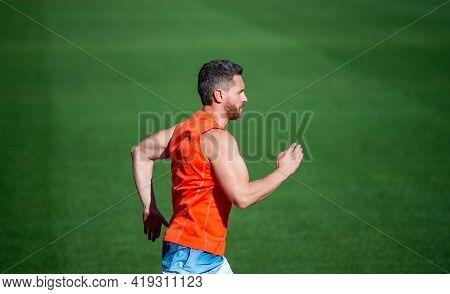 Sport And Endurance. Outdoor Stadium Sprint. Physical Training. Athletic Guy Run.