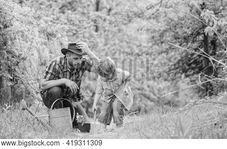 Planting Flowers. Dad Teaching Little Son Care Plants. Little Helper In Garden. Make Planet Greener.