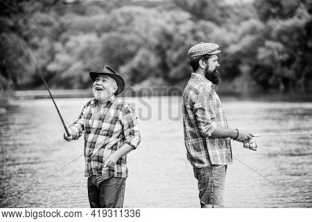 Good Days. Two Happy Fisherman With Fishing Rod And Net. Father And Son Fishing. Hobby And Sport Act