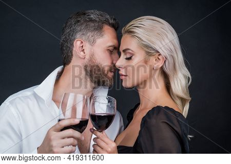 Cheers. Couple In Love. Couple Drink Champagne. Celebrate Special Occasion. Love Romantic Date.