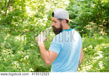 Hydration. Daily Water. Brutal Bearded Man Drink Bottle. Mature Hipster With Beard In Forest.