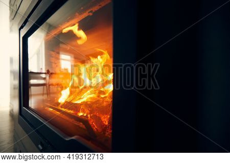 A Fire Burns In A Fireplace, Fire To Keep Warm. Logs Burning In A Fireplace