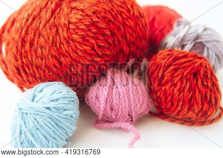 Balls Of Bright Multicolored Yarn On Light Background. Craft On White Background. Knitwear As A Conc
