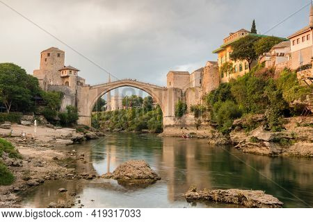 Stari Most bridge at sunset in old town of Mostar, Bosnia and Herzegovina. Mostar cityscape at summer