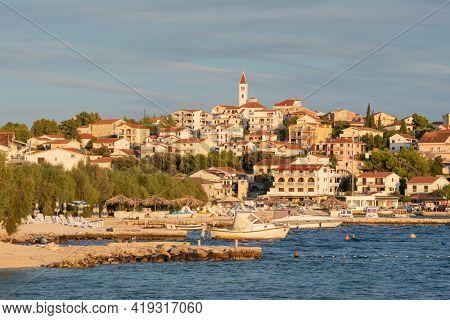 Small Mediterranean town Seget Donji near the Trogir town at Adriatic coast at sunset, Croatia