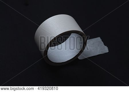 Paper Tape On A Black Background. Adhesive Tape