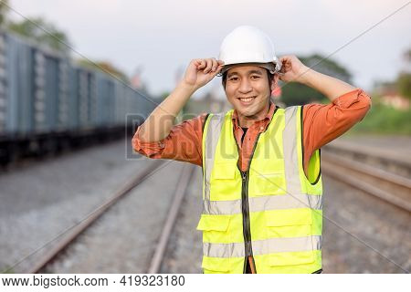 Portrait Engineer Man Working On Railway. Chief Engineer In The Hard Hat In Maintenance Facility, En