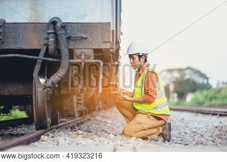 Engineer Man Sitting On Railway Inspection. Construction Worker On Railways. Engineer Work Using Tab