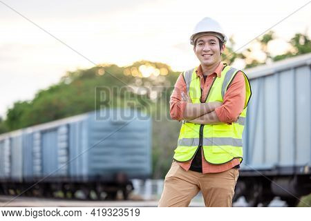 Portrait Engineer Man Working On Railway. Chief Engineer In The Hard Hat In Maintenance Facility, En