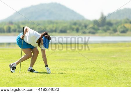 Golfer Sport Course Golf Ball Fairway. People Lifestyle Woman Playing And Putting Golf Ball Game On