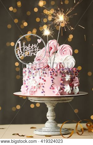 Beautiful Birthday Cake With Festive Decor And Sparkles On White Table