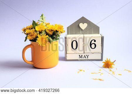 Calendar For May 6: Cubes With The Numbers 0 And 6, The Name Of The Month Of May In English, A Bouqu