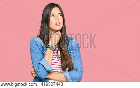 Young brunette woman wearing casual clothes touching painful neck, sore throat for flu, clod and infection