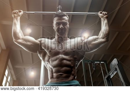 Old Fashion Bodybuilder Doing Pull-ups Exercises In Gym. Handsome Caucasian Sports Man Style Of The