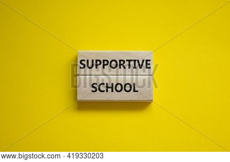 Supportive School Symbol. Wooden Blocks With Words 'supportive School' On Beautiful Yellow Backgroun