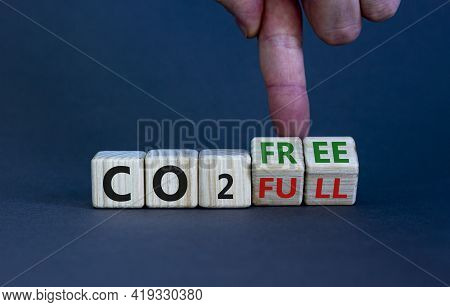 Co2 Full Or Free Symbol. Businessman Turns Cubes, Changes Concept Words 'co2 Full' To 'co2 Free'. Be