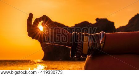 Banner. Young Womans Hand In Bracelets. Practice Yoga On The Beach With Sunset. Keeps Fingers Connec