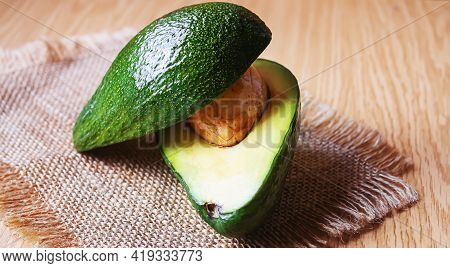 Avocado And Avocado Oil On Wooden Background. Selective Focus.