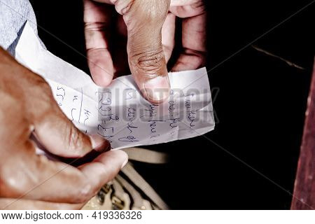 Math Formulas And Equations Written On A Paper Chit For Cheating In The Examination With Only Finger