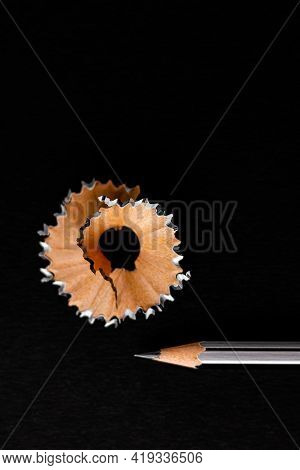 Top Close Up Shot Of A Pencil Shaving In Round Design Shot Over Black Background -classroom Concept